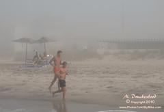 Early morning beach joggers at Cape May NJ (PhotosToArtByMike) Tags: ocean sea seascape beach landscape newjersey surf earlymorning scenic nj joggers foggymorning capemaynj capemaynewjersey capemaybeach landscapephotograph