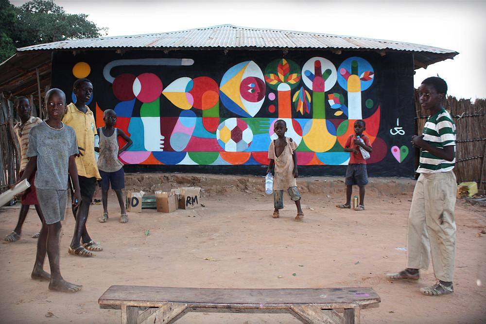 MONKEY ON BOAT WITH MANGO TREES. Galoya, GAMBIA. 2011.