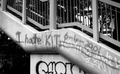 I've changed my mind: I hate Kit (Joybot) Tags: china 2001 bw hk white black film public 35mm hongkong 50mm graffiti asia stair paint grafitti cross painted spray drip step staircase hate angry change asie  date  kowloon fu