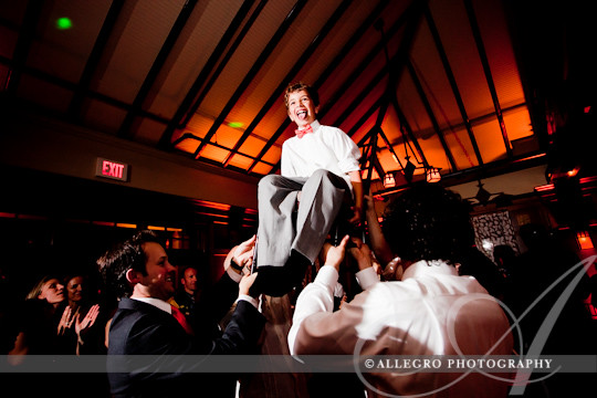 look-park-wedding-northampton-ma-reception- groom's son goes up in the chair for the horah
