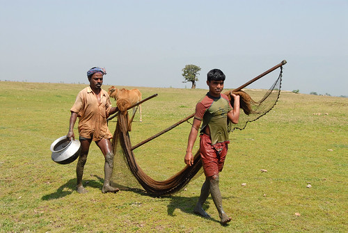 Two fishermen on their way to the pond, Bangladesh. Photo by WorldFish, 2007