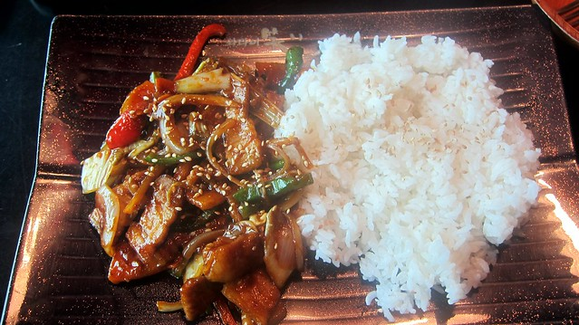 stir-fry pork over white rice at cafe soho
