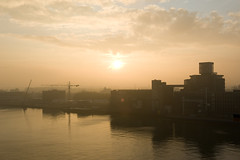 Rijnhaven Sunrise (Bart van Damme) Tags: bridge summer urban sun mist reflection industry water netherlands colors beautiful lines bicycle misty fog river boats mirror sketch rainbow rotterdam raw colours harbour drawing ships sketching thenetherlands bluesky cranes shore montevideo buckminsterfuller maas kopvanzuid chemtrails meuse geodesicdome meccano laspalmas dehef wilhelminapier brienenoordbrug katendrecht rijnhaven rivermeuse skylinerotterdam codrico rotterdamskyline maastoren benthemcrouwelarchitects cite rotterdamclimateinitiative erasmusbrugunstudio codricofoodindustries cornflourindustries kpnbuildingrenzopiano 1989mecanoo tangramarchitecten inhollandegeraat derotterdamremkoolhaasoma montevideomeccano dampartnersarchitecten neworleansbyalvarosizaarchitects laspalmasbybenthemcrouwelarchitects johnkormeling rotterdamclimateproof deltasyncpublicdomainarchitects citebytangramarchitects