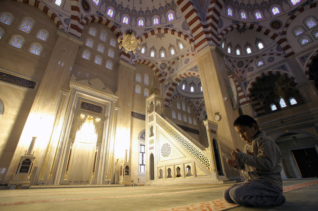 A Chechen boy prays in the main mosque in Grozny, Russia,