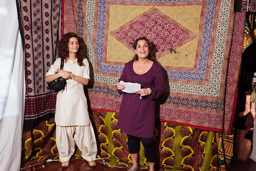 Performer Marcela Descalzi with volunteer Soha Irani