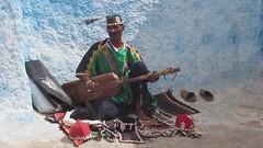 Street musician in Rabat. (Linda DV) Tags: africa travel canon geotagged video morocco maroc rabat gnawa 2011 guimbri sintir almarib  gimbri lindadevolder powershotsx30