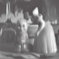 Bashful and Snow White (kevin dooley) Tags: bw white black film analog mediumformat fun pepper lomo lomography kiss funny michigan cartoon salt saltshaker disney pinhole container diana shaker characters snowwhite kissed summervacation peppershaker bashful pinnie 2011