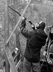 Alastair smashing some clays (peckhamryecrow) Tags: blackandwhite bw 35mm mono scotland highlands hp5 paulgray claypigeonshooting leicam3 alastairgreen minoltascanmultiii leicasummicron50mmf20dr rothiemurchusestate timgreen ilfoteclc29119 peckhamryecrow believeinfilm