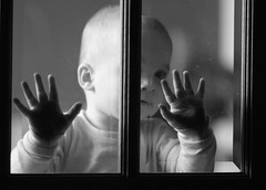 Touching the Darkness (Philocycler) Tags: blackandwhite baby beauty hands toddler canon85mm18 cutec canonrebelt2i touchingthedarkness