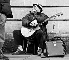 I used to be a Banker. (Neil. Moralee) Tags: street uk musician man hat socks hair beard glasses nikon shoes guitar amp somerset devon exeter strings busker stool amplifier facial voyer taunton d5000 neilmoralee