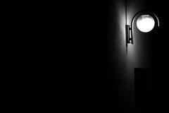 A light in the dark (Isengardt) Tags: light bw wall dark lampe licht wand hell sw dunkel birne dster