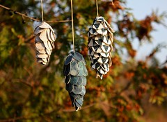ornaments in the late day sun (knitalatte11) Tags: christmas holiday triangles handmade linen handstitched cones hemp handmadegifts indigodyed libertytanalawn ornamentsforbookhou bookhoufabric