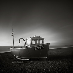 E293 (Andy Brown (mrbuk1)) Tags: longexposure light shadow seascape reflection beach contrast square mono boat blackwhite sand horizon shingle shoreline pebbles dorset beached aground tone trawler branscombe nd110 leefilters