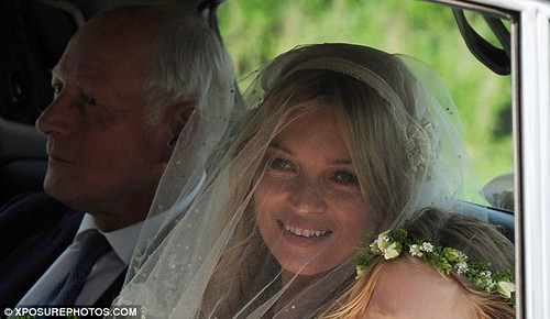 The first look at Kate Moss as she arrives at St Peter's parish church for her wedding
