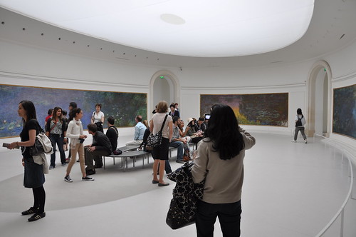 A rounded room of Monet works