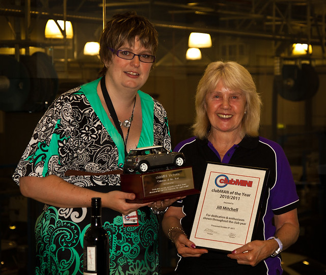"Jill Mitchell is presented with ""Clubman of the Year"" by outgoing president Ruth Harrison Brown"