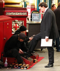 businessman getting a shoeshine (TBTAOTW2011) Tags: man black leather businessman shoe shine polish business suit shoeshine loafers