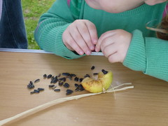 Children enjoy learning how to make birdfeeders