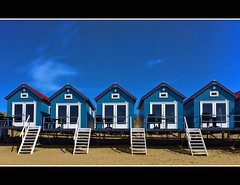 wood blue red sky white house holland colour beach window... (Photo: Wim Koopman on Flickr)