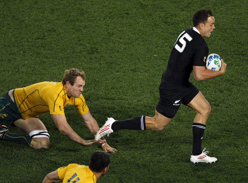 All Black Israel Dagg runs past Australia's Rocky Elsom, left, during their Rugby World Cup semifinal at Eden Park