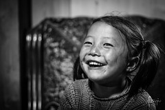 Shangri-La, China (Foraggio Photographic) Tags: china travel portrait blackandwhite girl monochrome smile happy mono asia altitude shangrila dailylife yunnan travelphotography tibetangirl deqeng