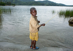 Kid in Lake Kivu - Rwanda (Eric Lafforgue) Tags: africa water childhood outdoors kid fishing eau child rwanda afrika enfant commonwealth peche oneperson greatlake afrique eastafrica lakekivu gisenyi lookingatcamera centralafrica kinyarwanda ruanda 0756 lackivu grandlac afriquecentrale  gisenye  regardcamera   kisenyi republicofrwanda   ruandesa