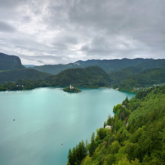 Picturesque Bled island on a glacial blue lake (Bn) Tags: pletna bled slovenia alps lake castle romantic feet water idyllic island mountain slopes hiking relaxing swan glacial two girls women alpine picturesque tourist medieval kasteel ducks swim romance summer holiday blue barna blejski travel slnblejskiotok slovenian cerkev marijinega vnebovzetja churchofstmaryontheisland stmary geotagged geo:lon=14090706 geo:lat=46362293 50faves topf50 100faves topf100 cloudy day