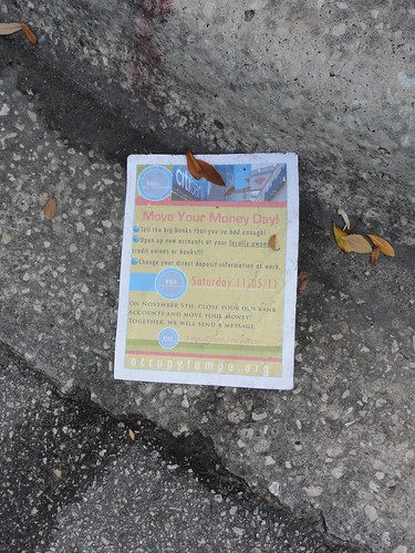 An Occupy Tampa flyer lies in the gutter