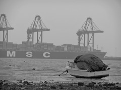 Harwich Harbour, Essex (DaveJC90) Tags: blue sea blackandwhite bw colour detail beach water grey bay boat movement ship harbour crane move sharp essex dull dovercourt felixstowe harwich sharpness