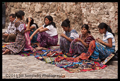 Selling textiles (2) (j.sonsteby) Tags: street girls people colorful guatemala scene clothes antigua textiles selling indigenous siting