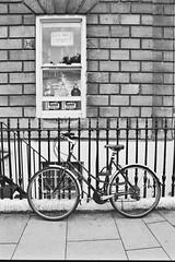 untitled (Tegan Howard) Tags: city blackandwhite bw southwest film bicycle analog blackwhite nikon bath cornwall analogue ilfordxp2 ilford chemist nikonf70 thesouthwest cityofbath ilfordfilm teganhoward teganhowardphotography poppetpup wwwpoppetpupwordpresscom