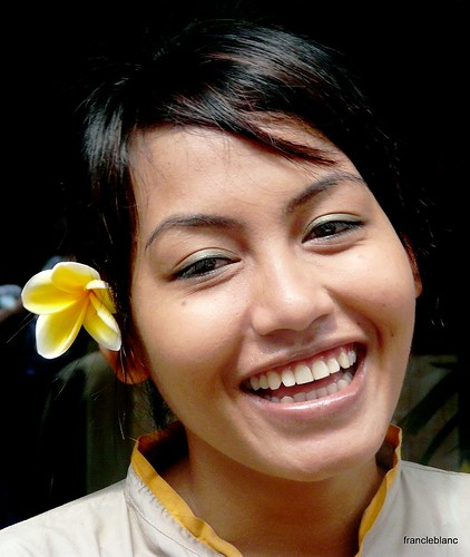 Girl with Plumeria flower .