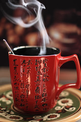 Coffee Dragon (panga_ua) Tags: morning red summer stilllife cloud black hot art cup coffee composition canon notebook japanese dof artistic bokeh availablelight dream screen ukraine steam curl graceful arrangement tabletop wisp hieroglyphs bodegon naturemorte artisticphotography naturamorta artphotography enticing warmcolor coffeedragon nataliepanga ukranianornament