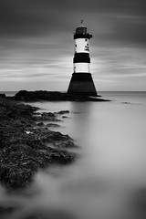 Penmon Lighthouse (Adam BStar) Tags: lighthouse mist seascape black water glass rock misty wales canon point is rocks long exposure waves 7d l f4 penmon 24105mm