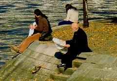 Lunch hour by the Seine (Gabriel Gets) Tags: street autumn portrait people paris france leaves seine river reading couples riverbank riverseine
