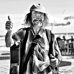 Nice singer (jm.trujo) Tags: people bw gente bn simpatia cantantecallejero streetbeachsingerinspain beachsingerinspain folkstreetsinger