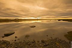 Landscape reflections (Gulli Vals) Tags: sky sun seascape water yellow stone clouds reflections landscape island iceland steinar vatn sl sk gulur skuggar forgrunnur mygearandme dblringexcellence gullivals