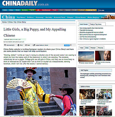 Little Girls, a Big Puppy, and My Appalling Chinese (My Son in China Daily) (faith goble) Tags: china travel man girl hat beard glasses fan newspaper costume screenshot essay cowboy funny robe kentucky ky picture silk teacher photograph american poet mandarin writer editor professor homeschool chinadaily yuan bowlinggreen bittersweet hunan honors expat expatriate wku westernkentuckyuniversity papertiger gpr faithgoble ganderpressreview brantgoble gographix faithgobleart
