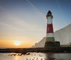 Beachy Head Lighthouse (Alan MacKenzie) Tags: sunset sea england lighthouse beach sussex coast aircraft cliffs contrails eastsussex beachyhead trinityhouse beachyheadlighthouse