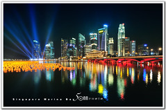 Singapore (fiftymm99) Tags: show city bridge blue urban reflection marina lights hotel bay cityscape fireworks bank tourist business laser countdown merlion sinagpore singaporeriver singaporeskyline merlionpark marinabaysands nikond300 fiftymm99 gettyimagessingaporeq2