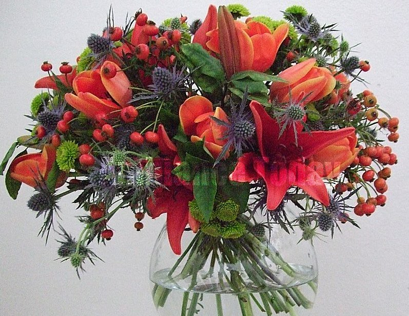 Orange/blue/green hand tied bouquet