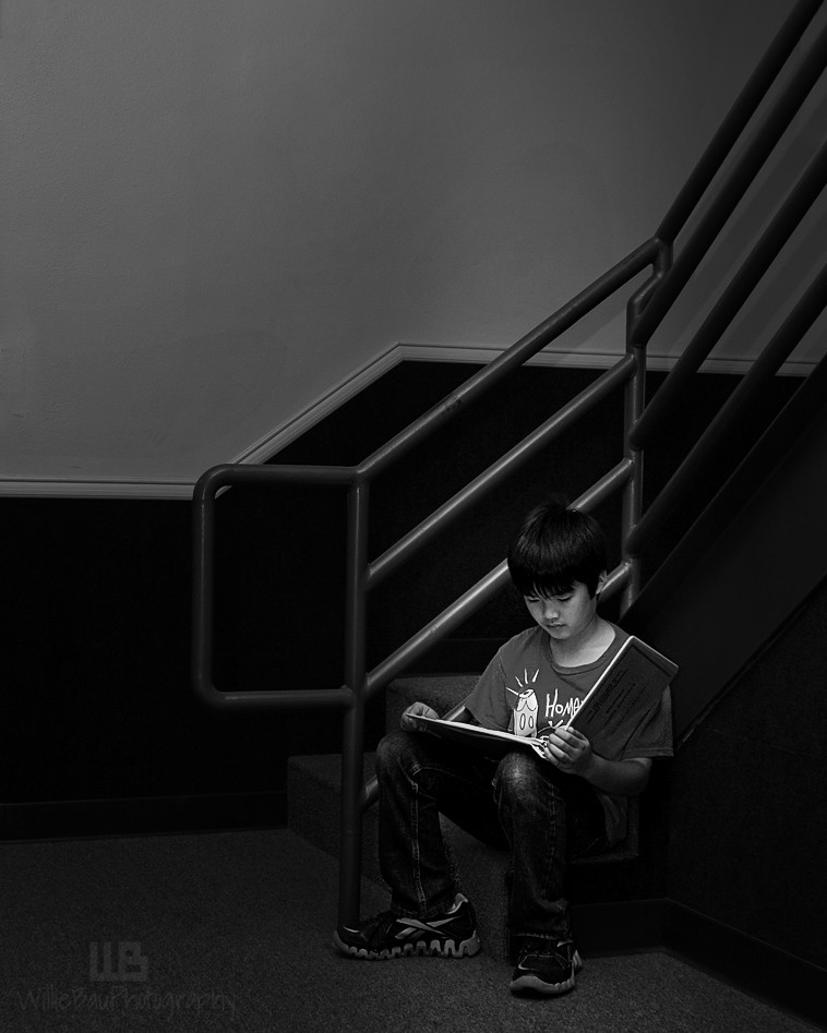 Boy Reading A Book...
