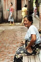 Woman at Mandalay alley (t3mujin) Tags: street city people urban woman relax happy prime alley asia burma myanmar nikkor mandalay slum d90 50mmf18daf