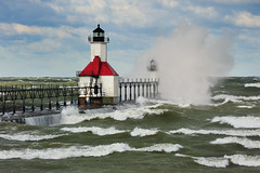 """Natures Canvas"" St. Joseph Lighthouse - St. Joseph, Michigan (Michigan Nut) Tags: sky usa lighthouse storm horizontal clouds america sunrise outdoors pier big midwest waves michigan nopeople landmark spray huge coastline splash johnmccormick stjosephlighthouse"