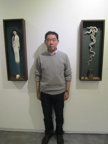 Ryo Arai with some of his work
