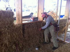Frank master baler inspects and adjusts the apprentices' work