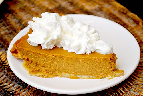 slice of homemade Libby's pumpkin pie topped with whipped cream