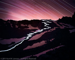The 97 Switchbacks at Night (Kurt Lawson) Tags: california longexposure light sky snow mountains film silhouette rocks path ngc crest 98 mount trail whitney moonlight lantern mountwhitney provia 97 startrails switchbacks mamiya7 trailcrest wotan 43mm wotansthrone explored stunningskies 99switchbacks 97switchbacks whitneycrest