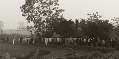Funeral Procession, somewhere in Rural Hanoi (vnkht) Tags: people blackandwhite bw sepia lumix countryside raw streetphotography line vietnam funeral fields procession coffin hanoi bandanas 2011 vitnam hni lx5 huyn whitebandanas gavinkwhite
