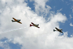 Southern Knights Harvard Formation Team - 15-202 (VH-YVI) AT-6G (Left), NZ1061 (VH-PEM) AT-6D Harvard III (Centre) and (VH-XNZ) AT-6C Harvard IIA (Right) (Wings and Wheels) Tags: sky heritage museum clouds vintage airplane airport team force aircraft aviation military air harvard country australian royal australia aeroplane historic formation southern knights ii nsw airforce naval warbirds raaf regional downunder formations at6 aerobatics snj aviationmuseum 2011 iia snj4 royalaustralianairforce 7667 temora flyingdisplay formationteam at6g ytem temoraaviationmuseum southernknights 15202 at6c vhxsa vhxnz warbirdsdownunder warbirdsdownunder2011 vhyvi nz1024